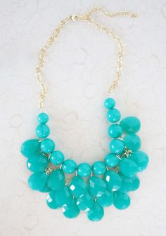 """Hidden Gem Bib Necklace 22.99 at shopruche.com. Faceted drops and marbled teal beads drip from this elegant gold colored necklace.17"""" long, Adjustable closure"""