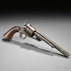 Identified Nickel-plated Model 1860 Colt Richards Conversion Revolver, c. late 19th century, serial number 198266, walnut grip, plated backstrap marked N.M. Nolan U.S.A., side of plated steel frame marked COLTS PATENT, triggerguard marked 44 CAL, steel cylinder has some remaining scene left, top of barrel marked ADDRESS COL. SAML COLT NEW-YORK U.S. AMERICA. Estimate $5,500-6,000