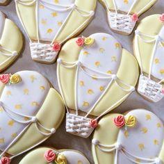 Hot air balloons for a baby shower. #hotairballooncookies #torontobakery #royalicingcookies #edibleart #thesweetesttiers #torontodecoratedcookies #babyshowercookies