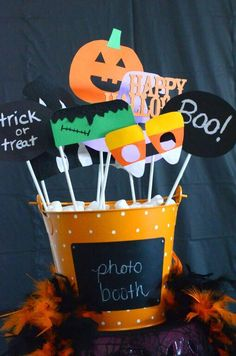 Halloween party photo booth ideas: DIY photo booth props and spooky backdrop.