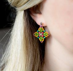 Colourful beaded flower earrings in green, orange, teal and fuchsia Handmade Jewelry, Unique Jewelry, Handmade Gifts, Green And Orange, Flower Earrings, Statement Earrings, Teal, Trending Outfits, Flowers