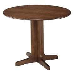 Ashley Stuman Round Wood Dining Table in Brown