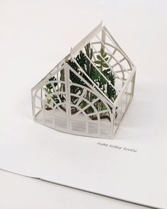 paper art Laser-cut leaves thrive within a delicate greenhouse. Featuring gold foil, laser-cutting, and a white vellum envelope. Vellum Envelope, Envelope Book, Papier Diy, Paper Pop, Paper Cut Out Art, Paper Cutting Art, Pop Up Art, Paper Engineering, Handmade Cards