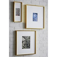 Shop gallery brass picture frames.   Exhibit your favorite photos gallery-style.  Creating a display of modern proportions, oversized white mat floats a single photo within a sleek frame of brass-finished aluminum.