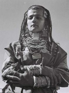 A Habbani Jewish woman from the Habban region in Yemen, wearing traditional silver jewelry. 1946. By Zoltan Kluger.