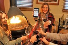 Locals enjoy wine at Corks n' Crowns Tasting Room in Santa Barbara's Funk Zone while cashing in on wine-tasting deals with Seeker, a new web-based app that allows users to purchase a wine tour on the spot.