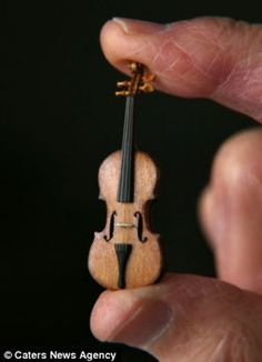 Tiny Violin Is The World's Tiniest Violin a great replica of the famous Strativarious...