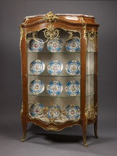 An Important Exhibition Louis XV Style Kingwood and Gilt-Bronze Bombe Vitrine, by François Linke and Léon Messagé French, circa 1890.