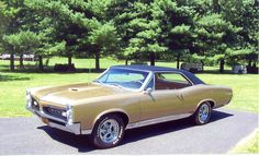 67 GTO My ride when hubby and I married looked just like this. CH.