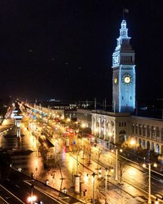 Nighttime lights up the San Francisco Embarcadero, as seen from a rooftop terrace at Hotel Vitale.