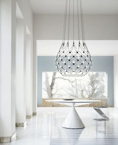 Designed by Francisco Gomez Paz for Luceplan, Mesh is a suspension lamp offering multiple lighting scenarios for personalized aesthetic and functional performance. Lamp, Decor, Lamp Design, Pendant Light, Mesh Lighting, Cool Lighting, Chandelier Lighting, Farmhouse Lighting, Ambient Lighting