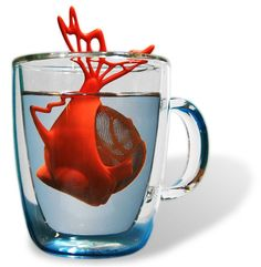 Dunkfush Tea Infuser ... in shape of fish with lacey fins holding a mesh tea ball in its stomach, in various colours, silicone and stainles steel