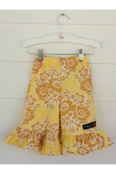 Ruffle Capris-Yellow Floral, fun large print. www.fabulousgirlboutique.com