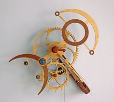 Space Time Continuum Wooden Clock not sure how to read it but like the wood colors