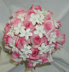 #bouquet, featuring pink roses and stephanotis blossoms with pearl centers