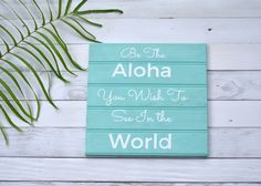 """""""Be the Aloha You Wish to See in the World"""" Sign. Our """"Be the Aloha You Wish to See in the World"""" Wooden Sign is inspired by the Aloha spirit and fits any lifestyle using reclaimed, repurposed wood from Hawaii. This up-cycled wooden sign is hand cut, sanded, painted and then dried on our lanai by the Hawaiian Sun. Choose from the designs that are already available or you may make requests in any color or font of your choice and we are happy to accommodate. $35.00"""