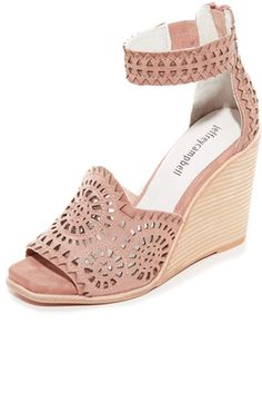676612ba81b ... perforations and zigzag trim add intricate detail to these suede  Jeffrey Campbell wedges. Exposed zip at the back and inset elastic at the ankle  strap.