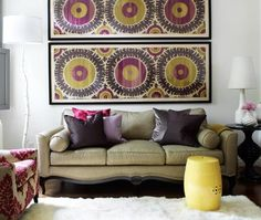white, flokati, rug, taupe sofa, Donghia Suzani in Pink Passion art panels, pink purple silver gray silk pillows, yellow garden stool, white & pink ikat chair, black accent table and white branch floor lamp.