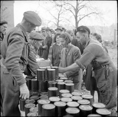 Rations being handed out to displaced German civilians, 28 March 1945.