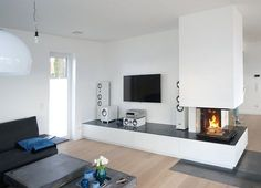 fireplace with large drawers - sizes . -Four-sided fireplace with large drawers - sizes . - DRU MAESTRO ECO WAVE - DRU - News and press releases Eckkamine von Rust - Westfalen Bielefeld Gütersloh tint meubelmaker Fireplace Console, Home Fireplace, Modern Fireplace, Brick Fireplace, Living Room With Fireplace, Fireplace Design, Living Room Decor, Paint Fireplace, Sala Grande