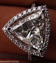 ffdc1c982727 Bulgari GRIFFE solitaire ring in platinum with heart cut diamond and 2 side  diamonds