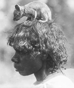 Indigenous Australian Aboriginal in outback Australia; A Ponga Ponga woman carries a pet possum, Northern Territory, Australia v Aboriginal History, Aboriginal Culture, Aboriginal People, Aboriginal Art, Australian Aboriginals, Indigenous Art, Indigenous Education, Out Of Focus, People Of The World