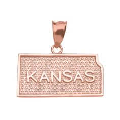 Kansas US State Map Charm Pendant in 10k Rose Gold. patriotic charm pendant depiction of the Kansas/Sunflower/Jayhawk State US Map with a star textured backdrop. expertly handmade with solid 10 karat rose gold (pink gold) in perfect polished finish. comes with free special gift packaging. made in the USA yet offered at factory direct jewelry price. ships from the manufacturer directly to the customers.