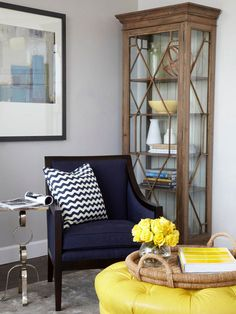 Navy, yellow, and slate gray hues look lovely in this space. See more of this home here: http://www.bhg.com/decorating/small-spaces/apartments/modern-condo/#page=5