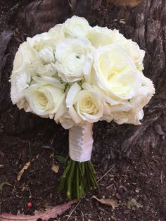 White bouquet of garden roses, hydrangea, ranunculus and standard roses for Hailey