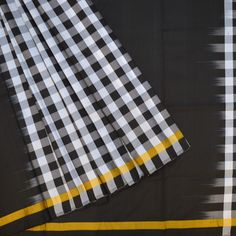 Woven Kanjivaram Handloom Pure Silk Sari : A Partley Paloo Soft Silk Saree With A Black Body And Black And White Checks For The Paloo, Blouse And Fleets. Key Features : Pure Silk l Ligh Weight l Party Wear l Handloom