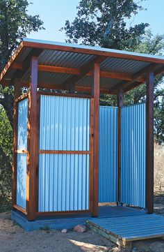 Corrugated metal sheets and western red cedar posts come together in this shower. - Corrugated metal sheets and western red cedar posts come together in this shower, designed by MyCar - Outdoor Pool Shower, Outdoor Shower Enclosure, Outdoor Toilet, Outdoor Baths, Outdoor Bathrooms, Douche Camping, Outhouse Bathroom, Outside Showers, Cedar Posts