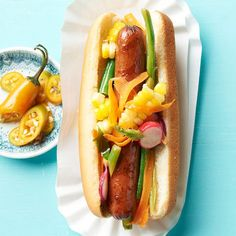 Farm-Stand Slaw Dog, plus 15 other summer-tastic hot dog toppers, including Hawaiian Dogs, Dr. Pepper Dogs, Chicago Dogs, & more...