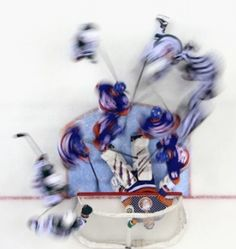 New York Islanders' goaltender Jaroslav Halak lies on the puck as action swirls around him during the second period against the Minnesota Wild at the Nassau Veterans Memorial Coliseum.