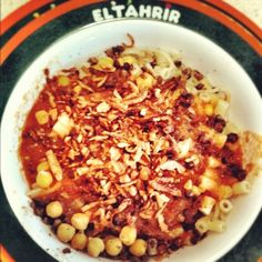 koshary- egyptian food made of lentil, chickpeas, rice, pasta, noodle and fried onions