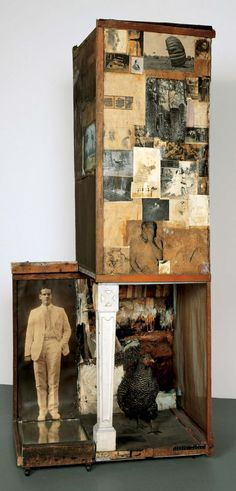 Rauschenberg - c.1954 Untitled (Man with the white shoes) Combine: oil, pencil, crayon, paper, canvas, fabric, newspaper, photographs, wood, glass, mirror, tin, cork, and found painting with pair of painted leather shoes, dried grass, and Dominique hen  (219.7 x 94 x 66.7 cm) Los Angeles