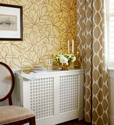 Enclose a dining room radiator to create a serving buffet. For a box like this, use a combination of 12s, 14s, and 18s for the frame. A 12-inch-wide shelf board forms the top, and painted pierced-metal panels in the center allow warmed air to pass through. | Photo: Stacey Brandford | thisoldhouse.com