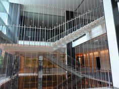 Metal balustrades and tension wire make for an open staircase, which becomes a feature of this open space.