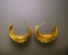 Earring    Object Number: 30-12-716A  Provenience: Iraq  Ur  Locus: PG 1237/16  Section: Near Eastern  Materials: Gold  Description: Larger, gold.  Credit Line: joint British Museum/University Museum Expedition to Ur, Iraq. The royal tombs of UR.