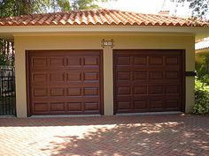 You cannot match the beauty of a wood garage door. The garage door in the photograph above started out as a typical white garage d. Faux Wood Garage Door, Metal Garage Doors, Garage Door Paint, Garage Door Makeover, Metal Garages, Diy Garage, Painting Metal Doors, Painted Doors, Garage Door Design