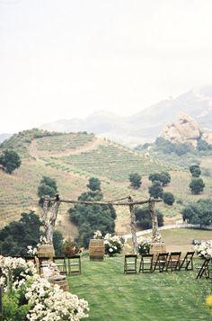 wooden wedding altar in vineyard