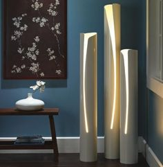 Lamps made from PVC pipe with cutouts from a jigsaw.