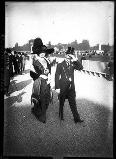 Stylish couple at the Longchamp race meeting, Bois de Boulogne on the banks of the Seine River, in Paris, c1910
