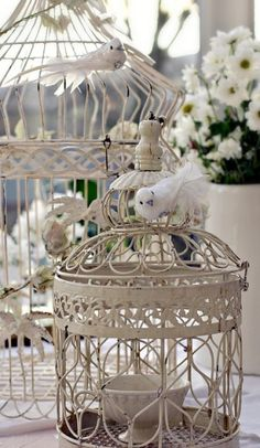 Cute white cage with white birdies on it.