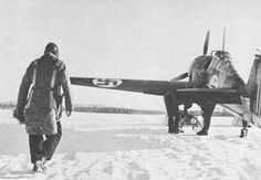 A Finnish pilot goes to get into his Fokker D.XXI fighter (1939/40)