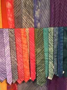 Hand dyed, cut, and sewn scarves and neck ties, Antrim Street Studio:  In need of scarves or neck ties? These colorful accessories from the Antrim Street Studio are all dyed, cut, and sewn by hand. Now available in the Fuller Craft Museum Shop!