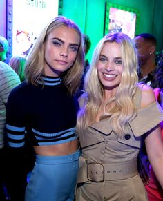 Cara Delevingne and Margot Robbie of 'Suicide Squad' attend the Samsung Experience at San Diego Comic-Con 2016 at Hard Rock Hotel San Diego on July 23, 2016 in San Diego, California.