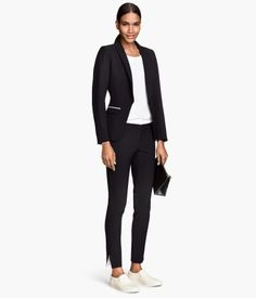 Suit pants in woven fabric with a contrasting waistband. Back welt pockets, tapered legs with slit at hems, and hook-and-eye fastener.