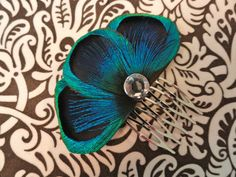 Peacock feather hair comb.
