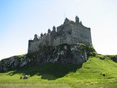 An atmospheric picture of Duart castle - note the rather ornate chimney-pots, added in the 1900s restoration. n 1911, the ruined castle was purchased by the grandfather of today's chief, Sir Fizroy Maclean. He lavished money on the castle to restore it to its original condition: and the fruit of his labours is the site you can visit today.