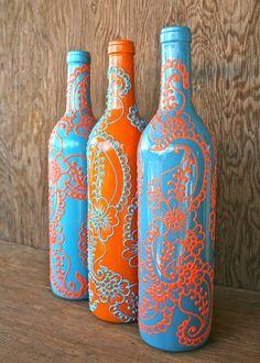 Set of 3 Hand Painted Wine bottle Vases, Turquoise and Coral Orange, Vibrant Henna style design. $70.00, via Etsy.